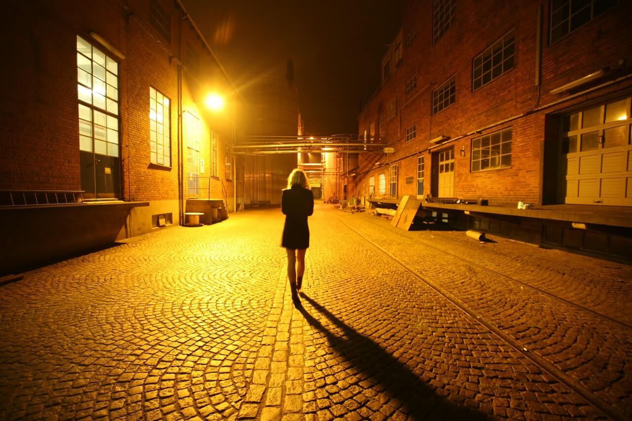 Women Walking on Street at Night