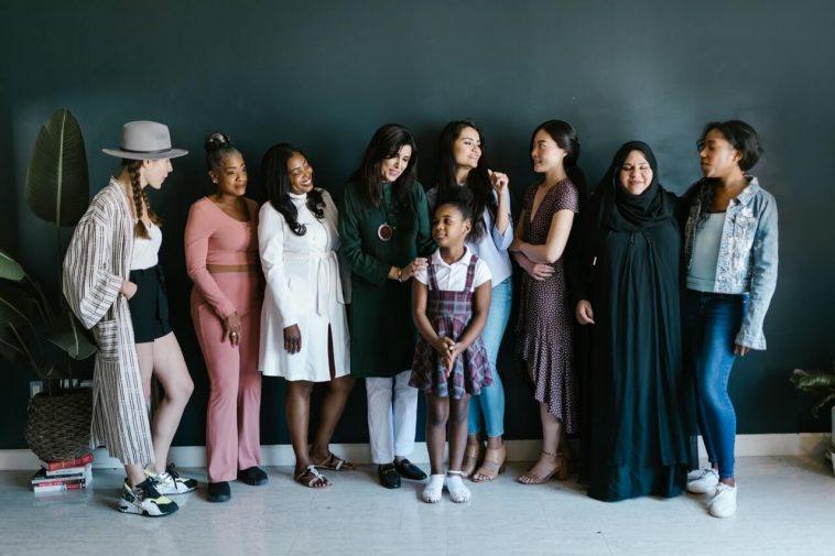 top stories women standing in group